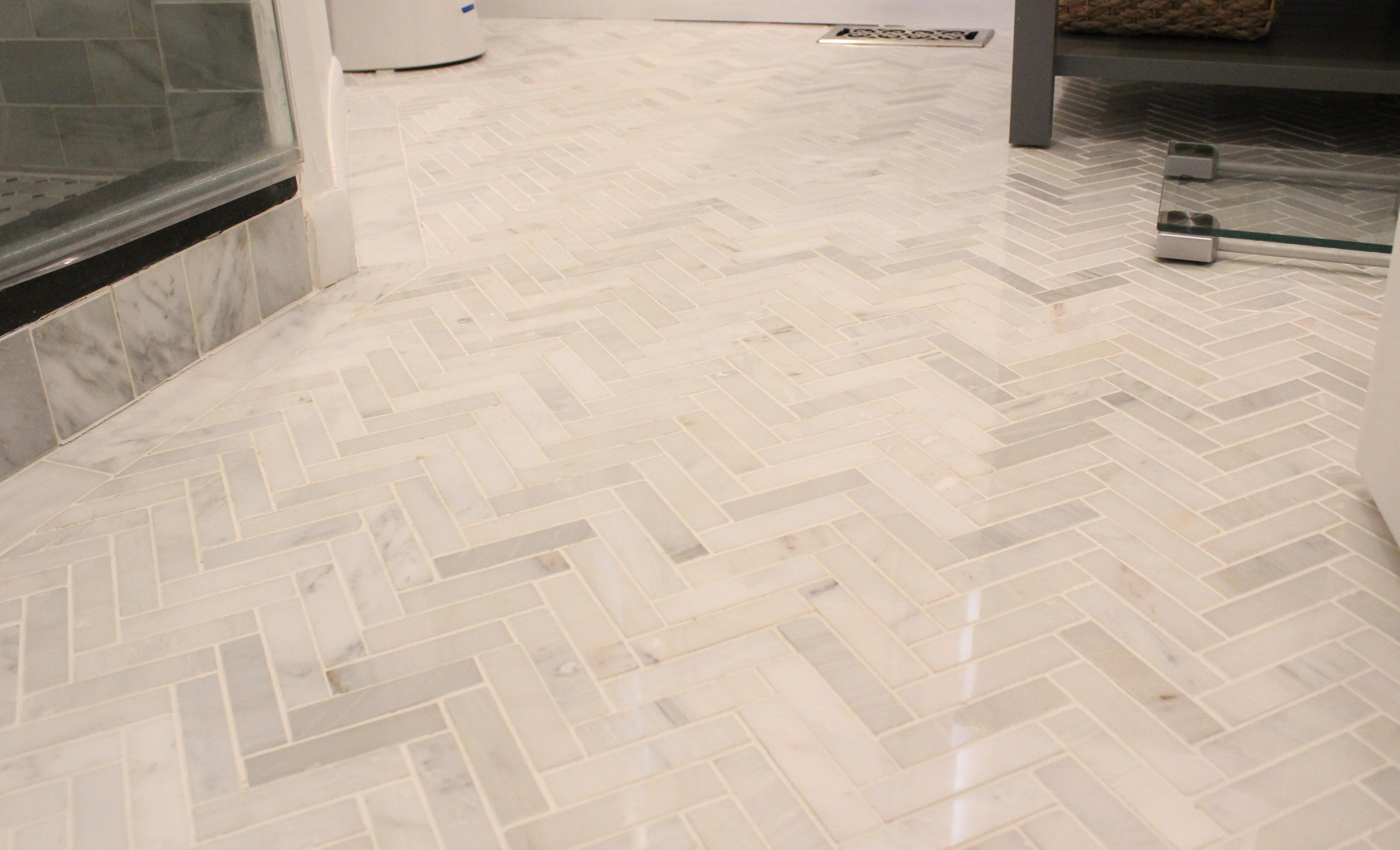 carrera marble herringbone tile bathroom floor